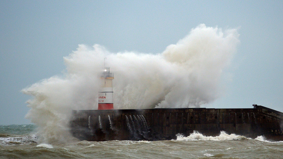 Waves crash against Newhaven Lighthouse in southern England on December 30, 2015, as 'Storm Frank' sweeps across Britain. With more floods forecast Wednesday as Storm Frank sweeps in, Britain is asking whether its defences can deal with extreme weather events, with many accusing David Cameron's government of negligence.  AFP PHOTO / GLYN KIRK / AFP / GLYN KIRK        (Photo credit should read GLYN KIRK/AFP/Getty Images)