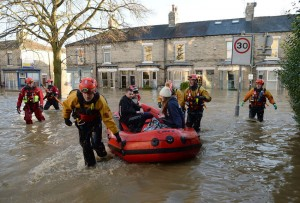 Winter weather Dec 27th 2015. Residents are rescued by members of the Mountain Rescue in Huntington Road in York, after the River Foss and Ouse burst their banks. Picture date: Sunday December 27, 2015. Hundreds more people are being evacuated as flooding continues to cause misery across the north of England. Prime Minister David Cameron will chair a conference call of the Government's emergency Cobra committee as the crisis deepens. Police advised between 300 and 400 people to evacuate in York by the River Ouse and River Foss, with hundreds more believed to be at risk. See PA story WEATHER Floods. Photo credit should read: Anna Gowthorpe/PA Wire URN:25112604
