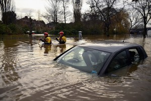 YORK, UNITED KINGDOM - DECEMBER 28: Rescue teams wade through flood waters that have inundated homes in the Huntington Road area of York after the River Foss burst its banks, on December 28, 2015 in York, United Kingdom. United Kingdom. Severe flooding has affected large parts of northern England, with homes and businesses in Yorkshire and Lancashire evacuated as rivers burst their banks. More heavy rain is forecast as dozens of severe flood warnings remain in place. (Photo by Jeff J Mitchell/Getty Images)