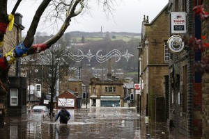 Winter weather Dec 26th 2015. A man wades through flood waters at Hebden Bridge in West Yorkshire, where flood sirens were sounded after torrential downpours. Picture date: Saturday December 26, 2015. See PA story WEATHER Floods. Photo credit should read: Peter Byrne/PA Wire URN:25108998
